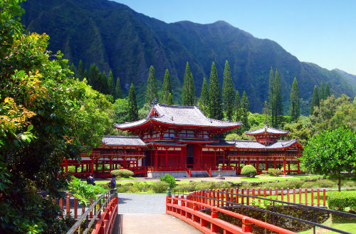 image of red bridge leading to the Byodo in Buddhist Temple, Oahu, Hawaii
