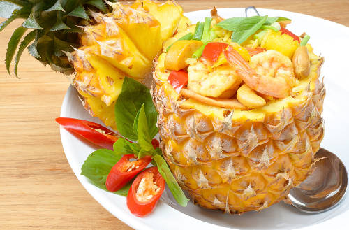 image of meal served in pineapple